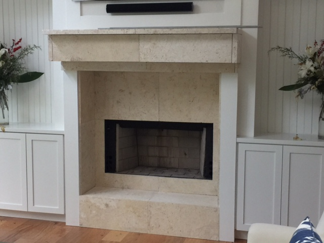 Attention to details, such as this mantel, help to achieve a space that is both functional and aesthetically pleasing.
