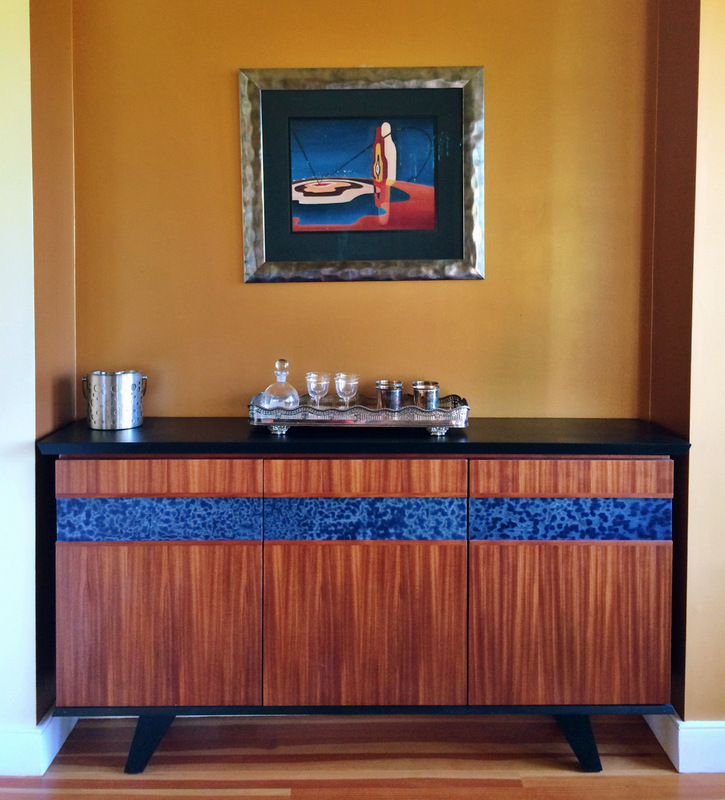 We chose a mahogany veneer accented by Japanese hand rolled glass and ebonized wood base.  This dining room credenza adds mid-century style to their mountain home.