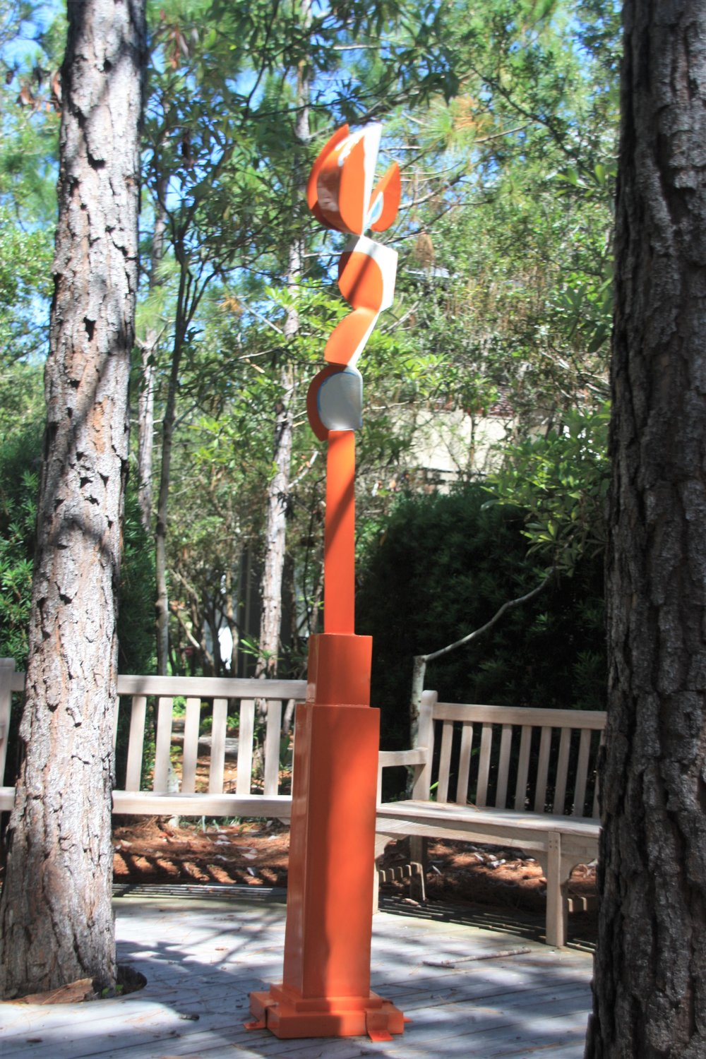 "Site 9 - Robert L. Coon, b. 1941Vero Beach, FLCreamsicle, 2015Fabricated and welded sheetaluminum; automotive paint96""x17""x14"" $10,000                                                                  ""This work came from memory, my favorite treat, a Popsicle with a vanilla center and orange covering called ""Creamsicle."""