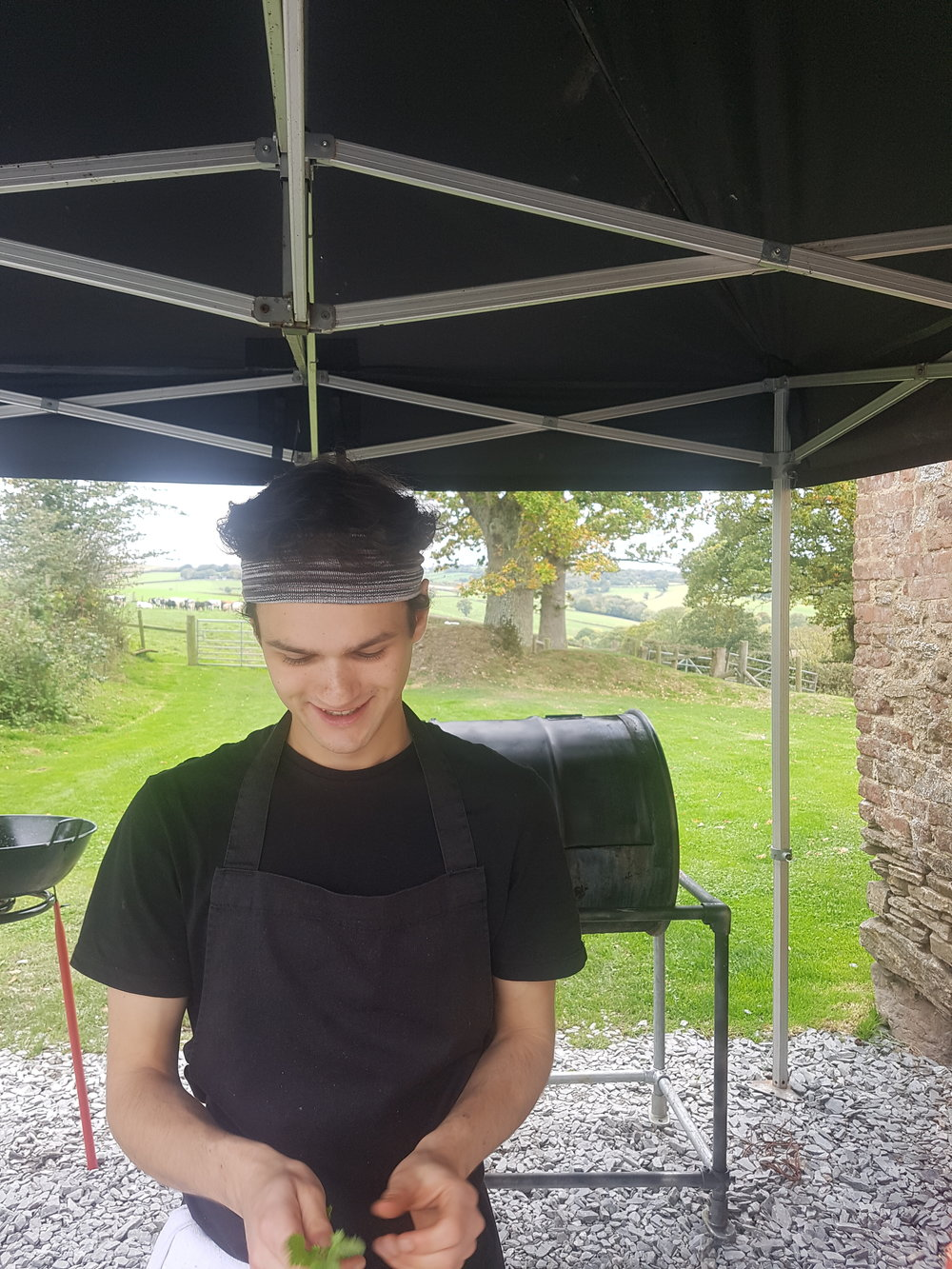Sous Chef Jacob getting ready for some hot smoked pork loin on the bbq at Higher Eggbeer Farm.