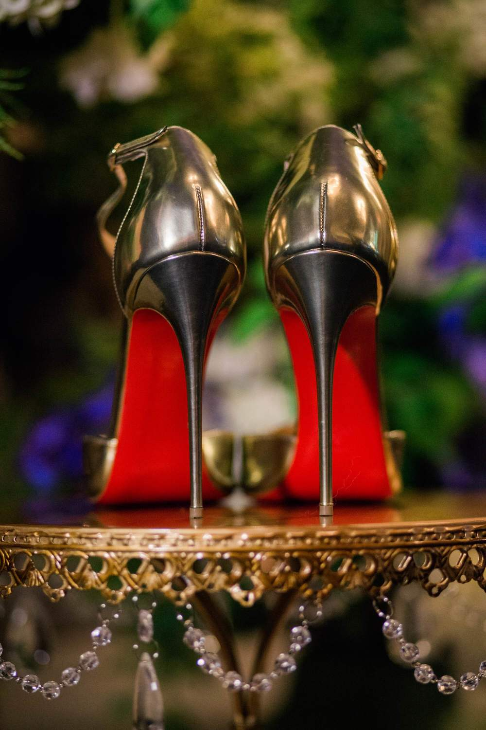 Louboutin heels on gold chandelier cake stand by Opulent Treasures