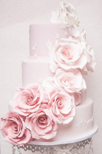 Pink Cascading Roses on Wedding Cake | Silver Chandelier Cake Stand