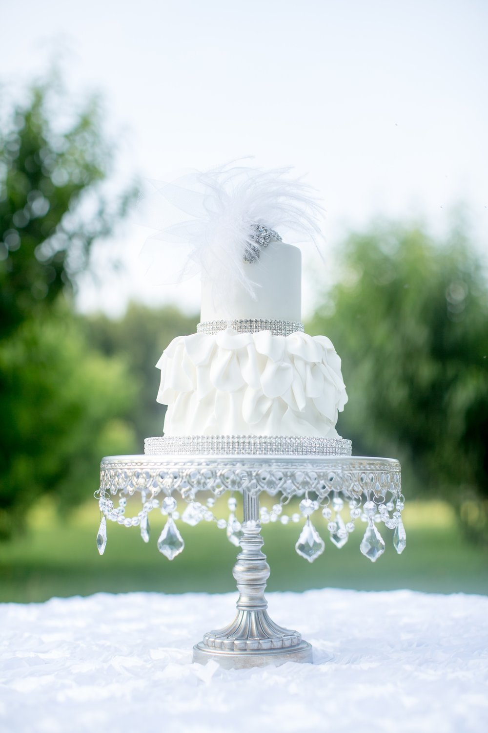 Couture Bling Wedding Cake by Cakes by Kim | Silver Chandelier Round Cake Stand