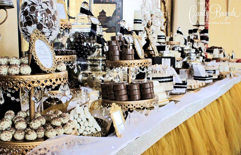 Candy-Brigade-dessert-table-gold-chandelier-cake-stands-opulent-treasures.png