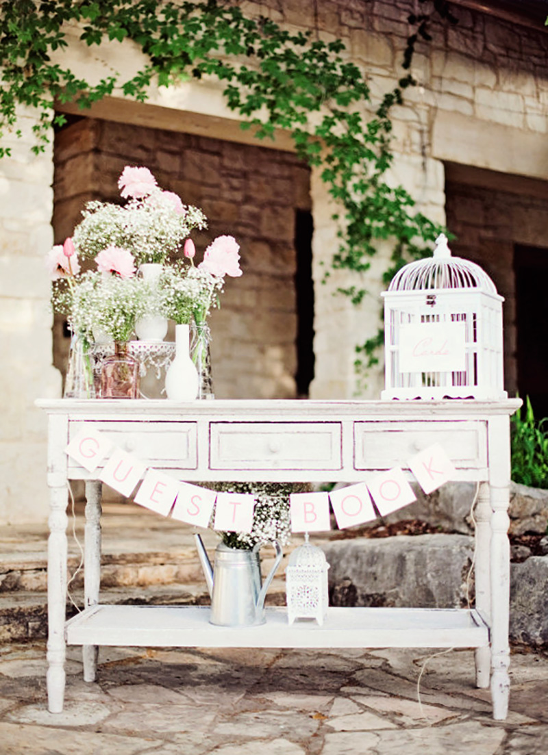 white-cake-stand-flowers-guest-book-table.jpg