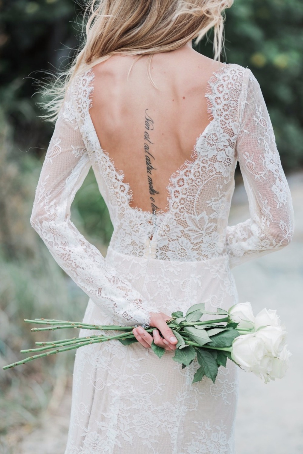 Allllll about that open back and eyelash lace trim and lace sleeves.    Goddess By Nature
