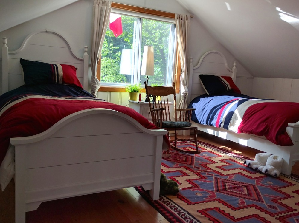 The loft bedroom has two single beds - perfect for kids or friends to share