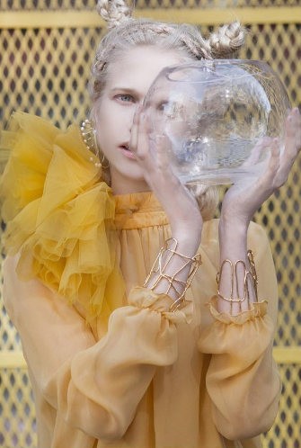 Editorial for Lucys Magazine featuring our designer Karie Lak's yellow silk blouse and golden Infinity Cuffs by our jewelry designer Iza by Silvia D'avila, Kasane, and The Modern Tales. All styles shoppable at Flying Solo and at Flying Solo online.