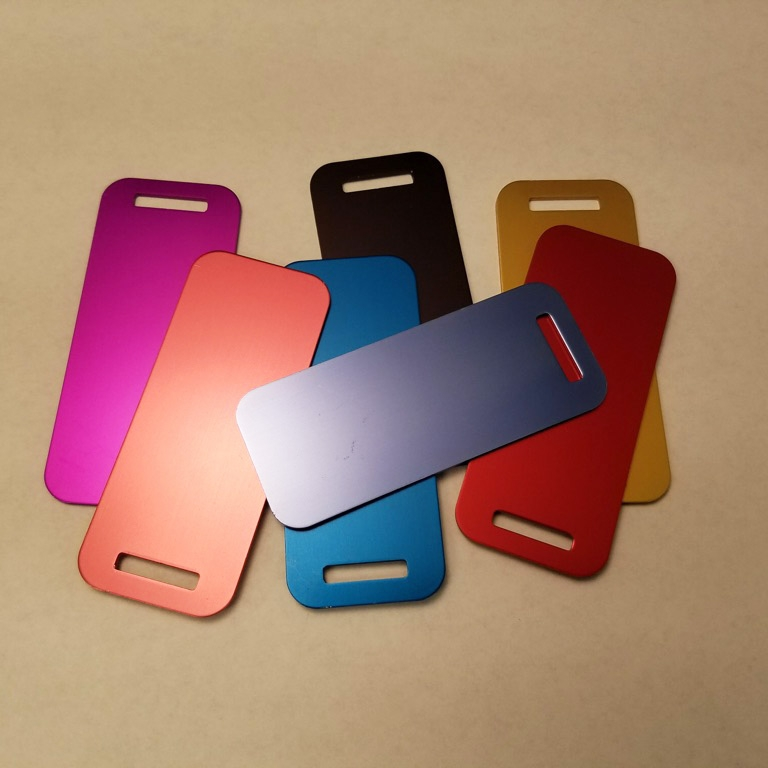 "Small Luggage Tag    Anodized Aluminum in Assorted Colors     3.00"" x 1.25""    MSRP $10"