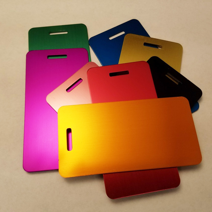 "Large Luggage Tag    Anodized Aluminum in Assorted Colors     3.88"" x 2.00""    MSRP $12"