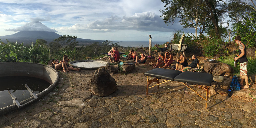 The InanItah community relaxing on the pool deck overlooking Volcán Concepción (the northern half of Ometepe Island).