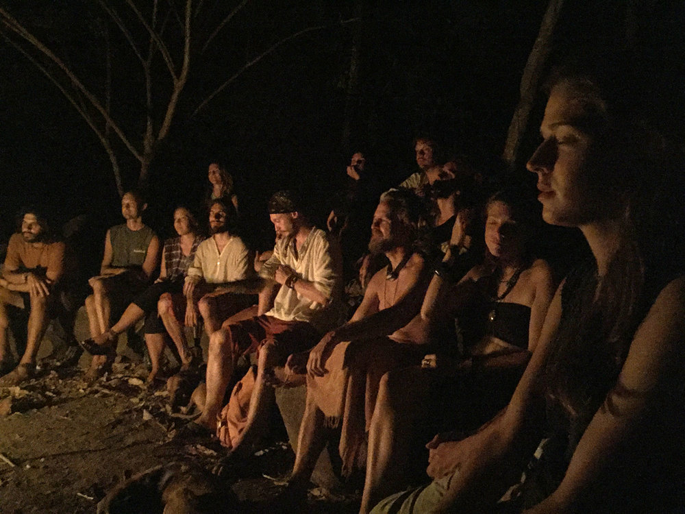 Poetry reading by firelight in the natural stone amphitheater at InanItah.