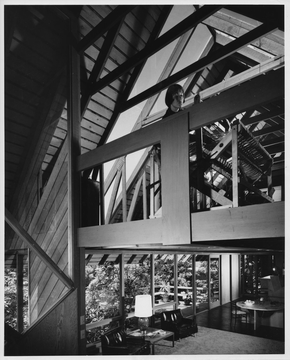 Here you can see my Mom, Jackie, up in the attic truss, in another photo by Julius Shulman.