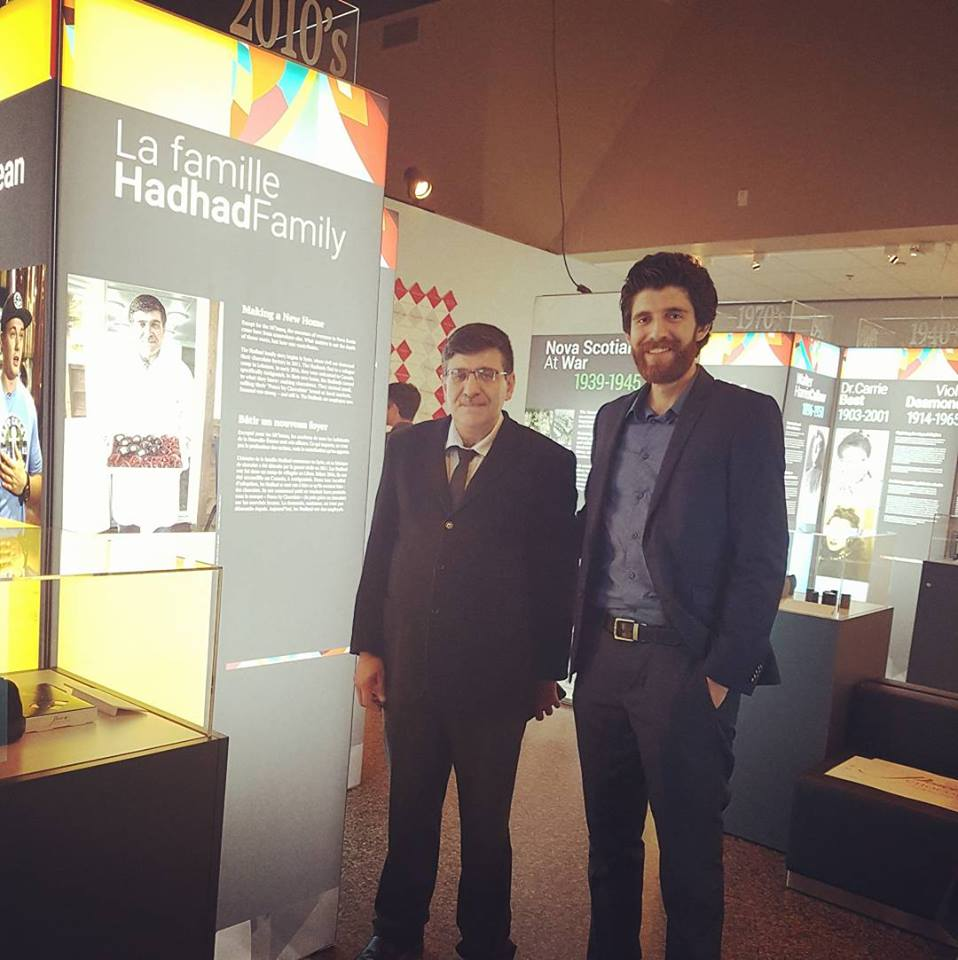 Isam Hadhad and Tareq Hadhad with the family portfolio at Nova Scotia Museum celebrating the opening of the  Vanguard: 150 years of Remarkable  NOVA SCOTIANS