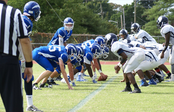Charter School of Wilmington's football team faces off during a game.  The football team has not been successful for a long time, prompting, in part, the switch in athletic conferences.