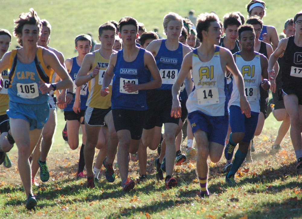 (Left to right, Connor Carp in rear, Chris Avila, Ben Snyder)  The boys begin their race on the challenging Brandywine Creek State Park 5K course with determined attitudes.  Photo by Joe Hackman.