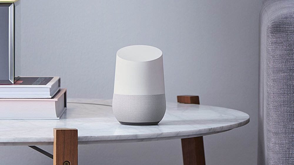 Picture of a white Google Home, source is from The Verge Website.
