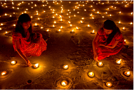 Hindus lighting candles for Diwali. Photo courtesy of Khoka Rahman via Wikipedia