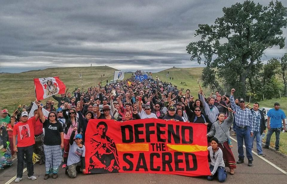 Hundreds of demonstrators gather on major highways to protest the Dakota Access Pipeline. Photo courtesy of the Indigenous Environmental Network.