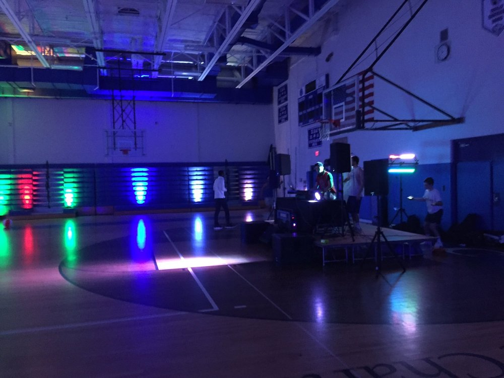 Cab Calloway's own DJ Rah, DJ Joey G, and their setup crew in Charter's A-Gym, moments before the doors opened. Photo by Grady McPeak.