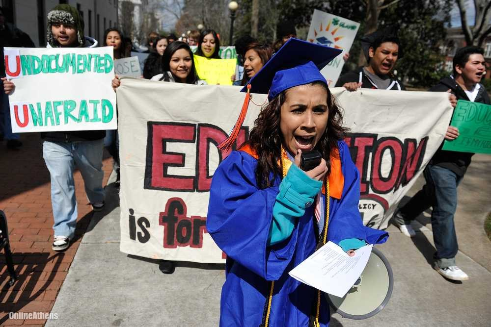 An undocumented high school graduate leads a protest against a ban on undocumented students at the University of Georgia. Photo from onlineathens.com.