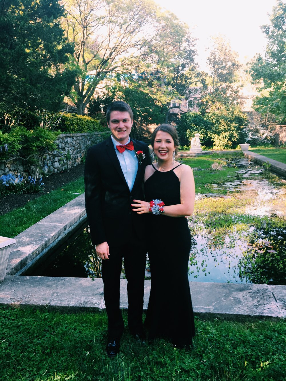 Right: Seniors Lilly Coleman and Pat Keegan stand in front of a reflecting pool for prom pictures. Photo courtesy of Lilly Coleman