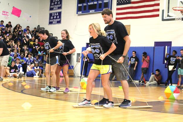 Ms. Degnan and Mr. Robinson surge ahead of Ms. Voltz and Ms. Vega in the teacher relay. Photo from Yearbook Club.