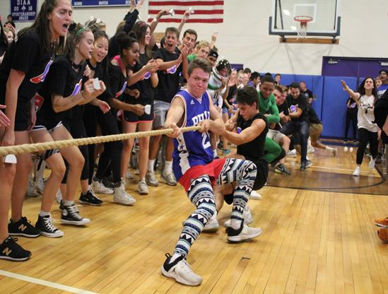 The seniors urge Jimmy Rich and his fellow seniors to pull harder in the tug-of-war contest. Photo from Yearbook Club.