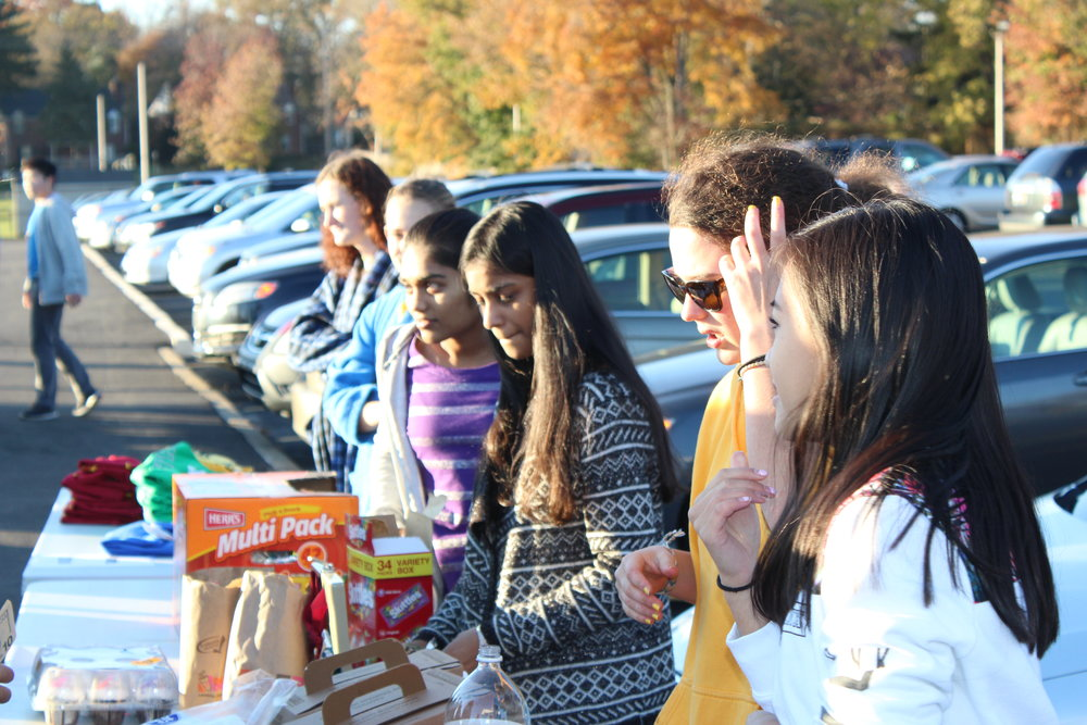 HUG Club members selling food and drink to raise money for Save the Children. Photo by Satvika Kadiyala.
