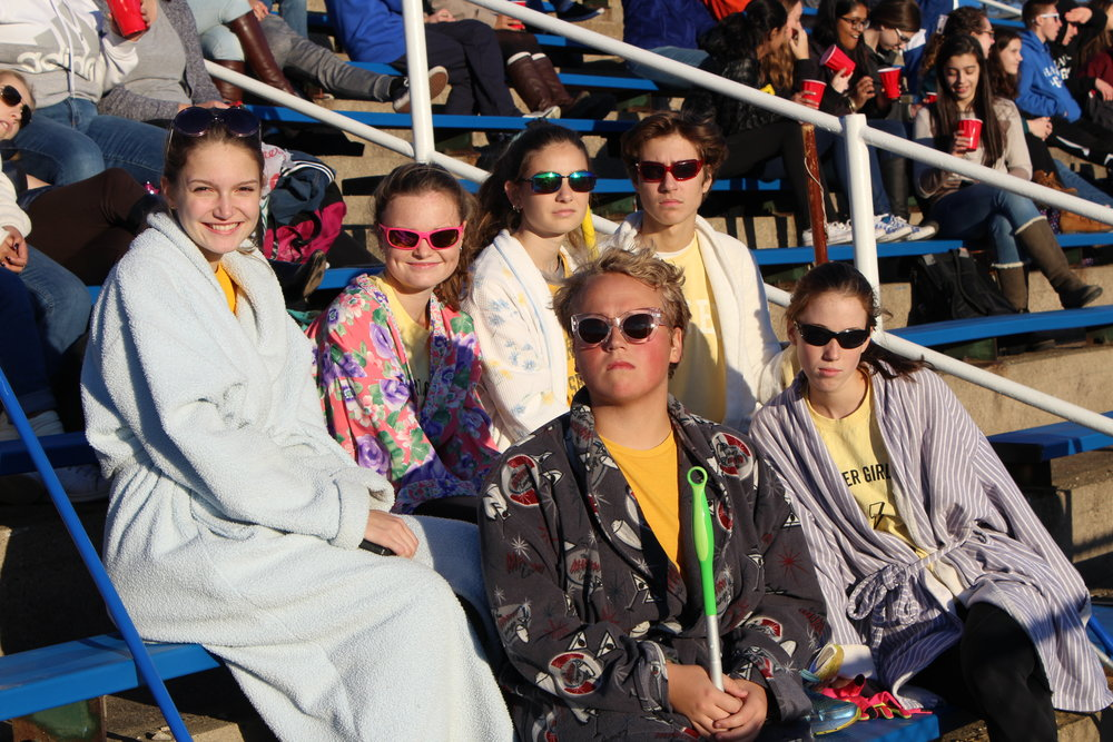 The Huffletoughs, wearing their team uniform of bathrobes. Starting in top row, from left to right: Diane Vinson, senior, Lizzy Barrish, senior, Livi Herdman, senior, Anthony Essick, senior, Jonathan Craig, senior, and Siobhan Mangan, senior. Missing is Katy Wilson, senior. Photo by Satvika Kadiyala