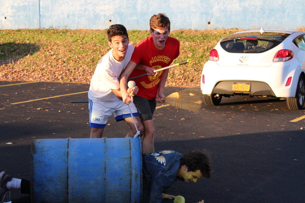 The showdown between Seekers sophomore Andrew Avila (in white) and senior Grady McPeak (in red). They are fighting over who first was able to catch Jack Seiffert, the Snitch. Jack is in the trash can, lying on the ground in this image. Photo by Satvika Kadiyala.