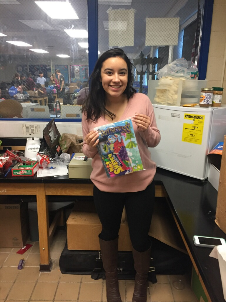 Senior Henna Castle poses with a completed kit for Emma's Art Kits. Photo courtesy of Henna Castle.