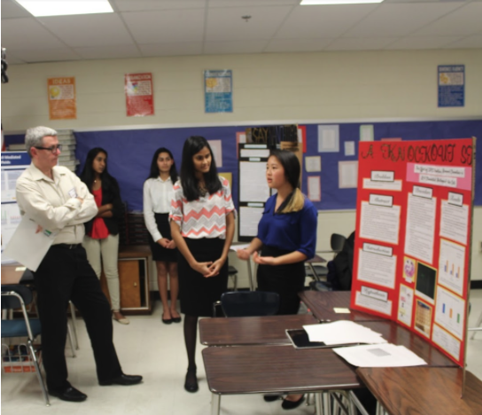 Juniors Priyanka Hoskere and Amber Wang present their research not only to the judges, but also to their peers. Photo by Satvika Kadiyala