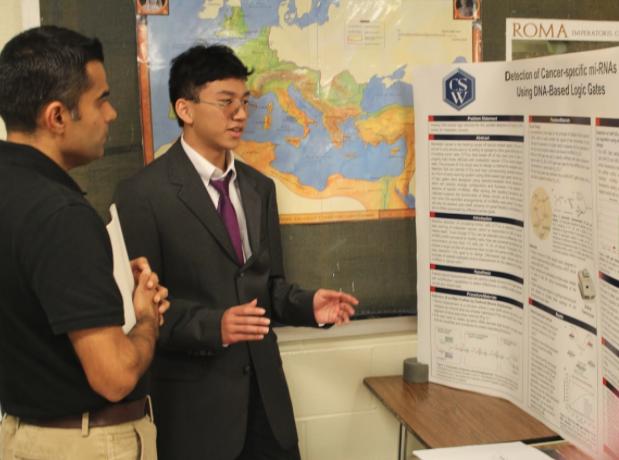 Junior Chris Chen and his complicated, but comprehensible research. Photo by Satvika Kadiyala