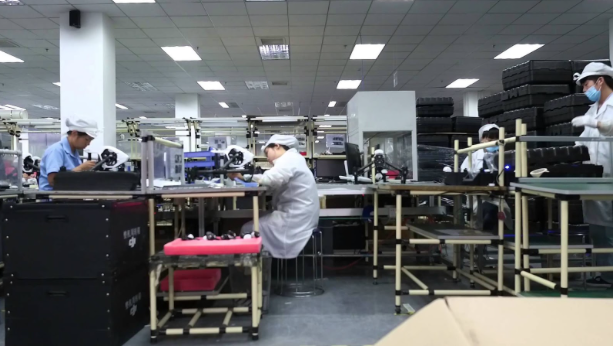 Photo from Youtube video DJI Factory Footage that shows workers assembling the drones.