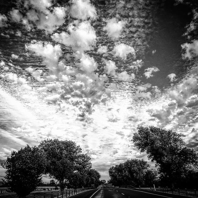 Headed home... #clouds #countryside #western #sky #blackandwhite #country #picoftheday