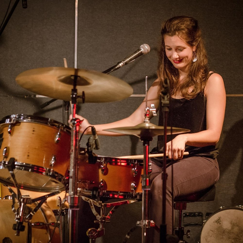Holly Norman on drums