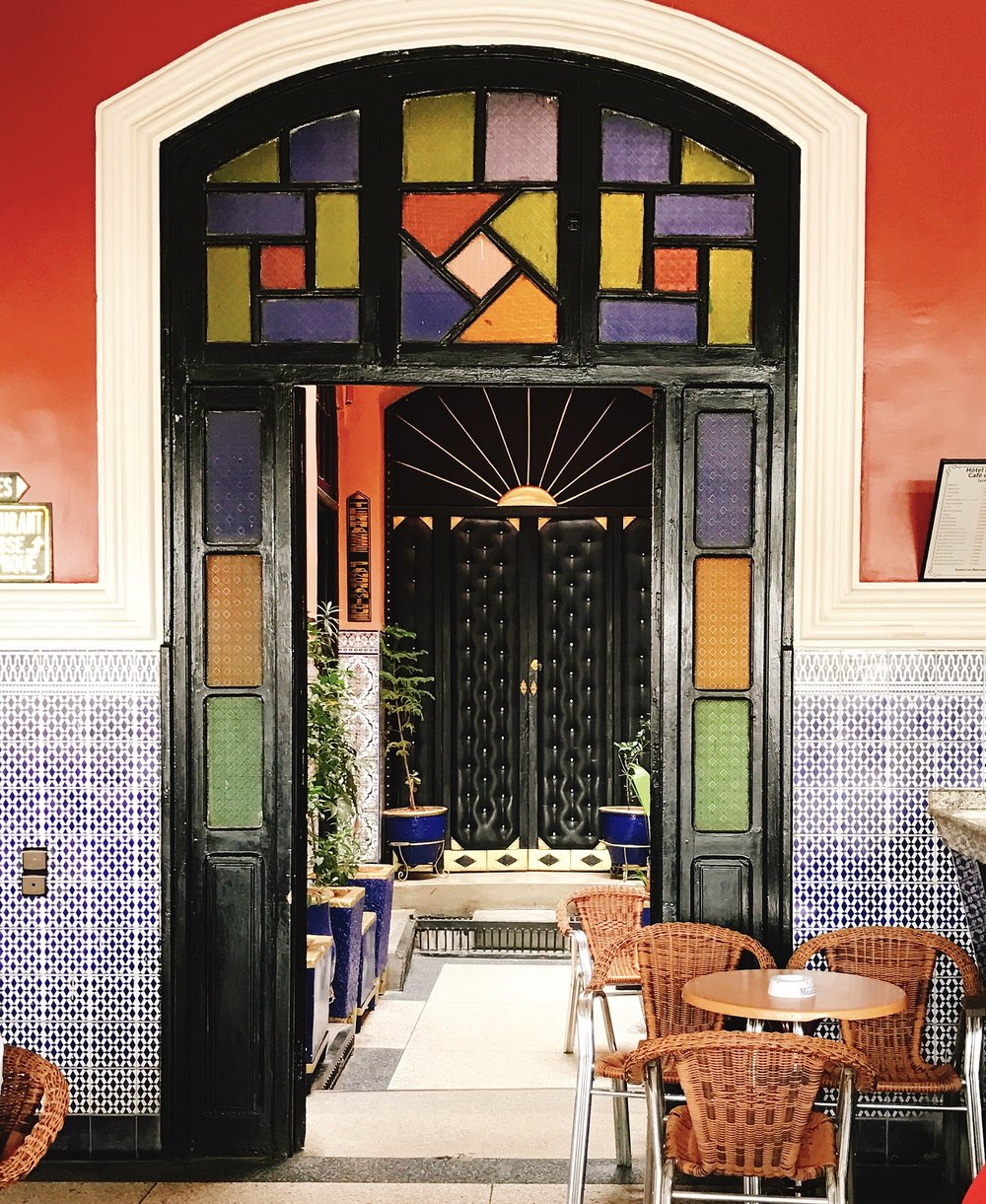 Inside Cafe de Paris-  The bright colors of the souks are echoed throughout
