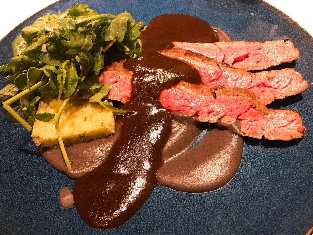 Carne Asada served with Oaxacan black mole