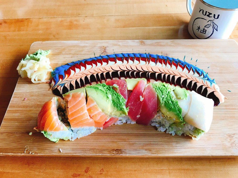 Over the Rainbow: Tuna, Salmon, Super White Tuna, Avocado, Unagi Spicy Mayo, Wasabi and Sweet Soy