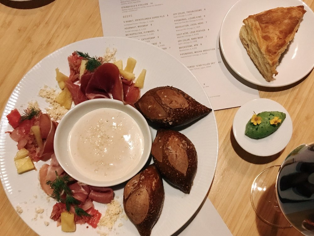 Bottom Left: Pumpernickel Pretzel served with Benton's Ham, Beer Cheese Fondue, and Pineapple; Top Right: Buttermilk Biscuit served with seasonal butter