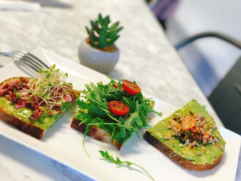 Avocado Toast Sampler: (Top to Bottom) Seoul Much Avo, Let's Avo Cuddle and Br-Avo