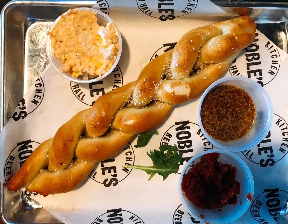 Beer Cheese and Pretzel Baguette served with Beer Cheese Smear, Sun-Dried Tomato Jam, and Sly-Rye Porter Mustard