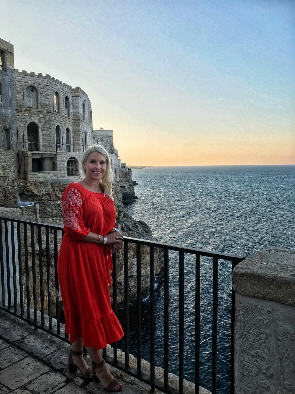 Overlooking the grotto restaurant in Polignano di Mare at sunset