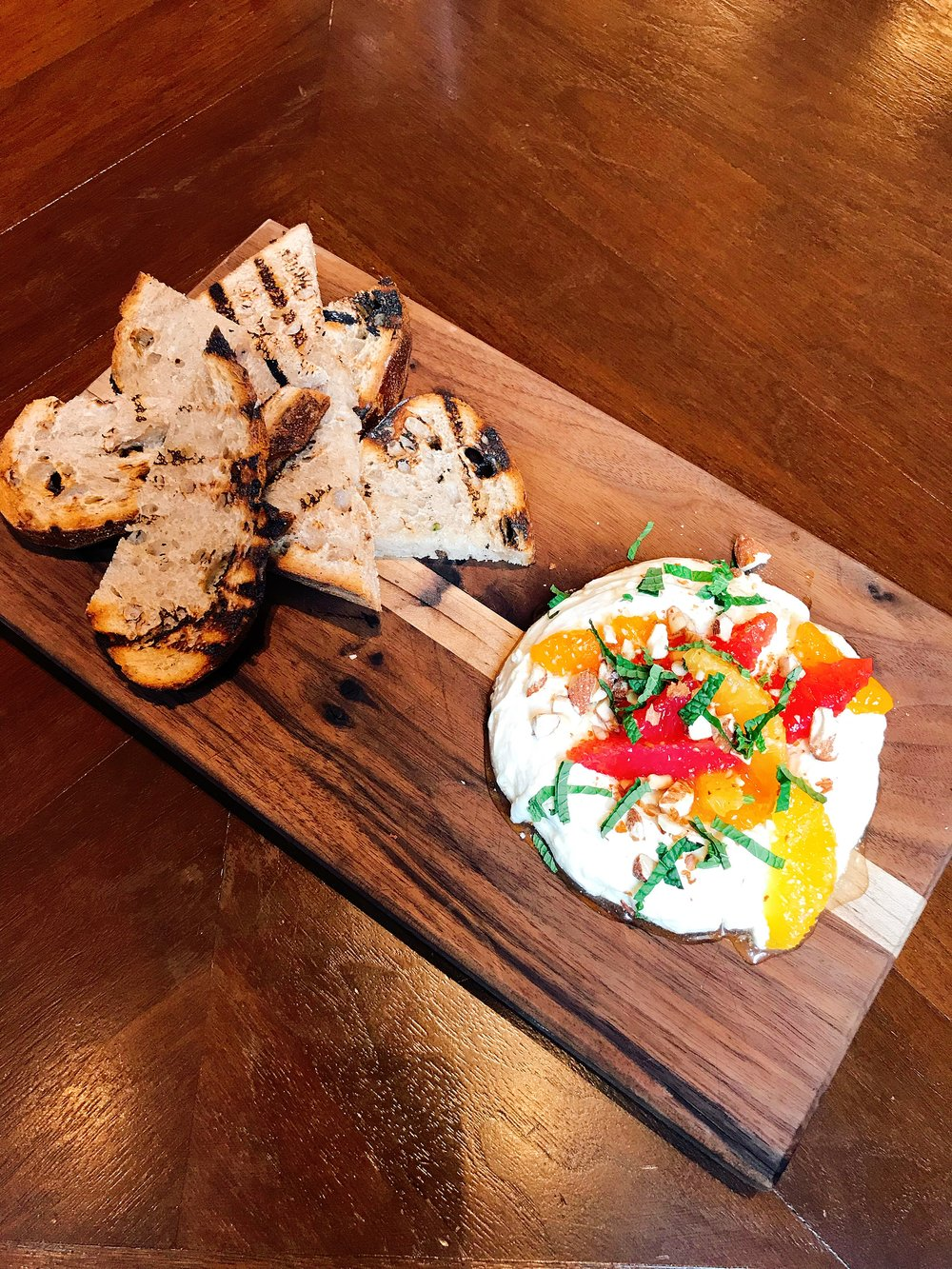 Fruit and Cheese featuring Sweet Grass Dairy Lil' Moo served with citrus, Tennessee honey, almonds, mint and served with a side of toast