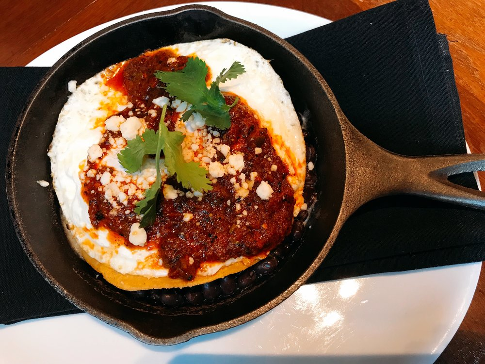 El Jefe Is Served With Two Eggs, Crisp Tortilla, Black Beans, Hearth Roasted Salsa and Queso Fresco.