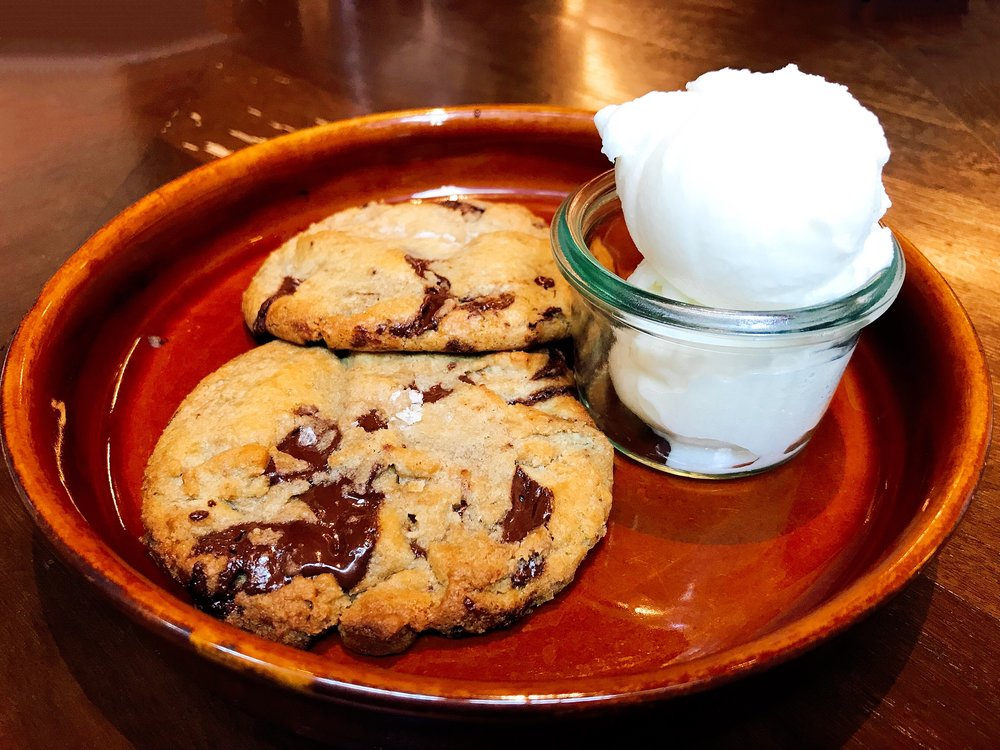 Warm Chocolate Chip Cookies Topped With A Pinch Of Sea Salt And Served With Ice Milk.