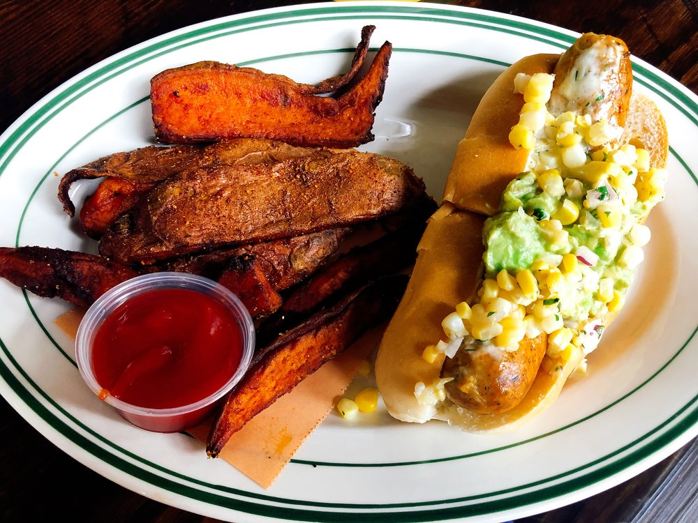 Angry Bird: Spicy Chicken Sausage Topped With Avocado, Buttermilk Dill Ranch And Corn Relish Served With A Side Of Sweet Potato Jojos