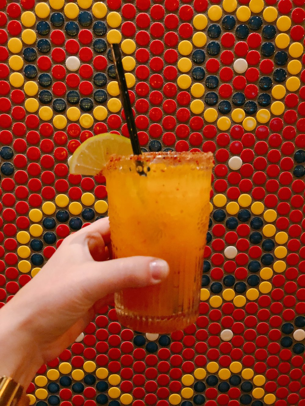 Chile-Mango Margarita: Tequila + House Curacao + Habanero + Mango + Ancho Chile Salted Rim