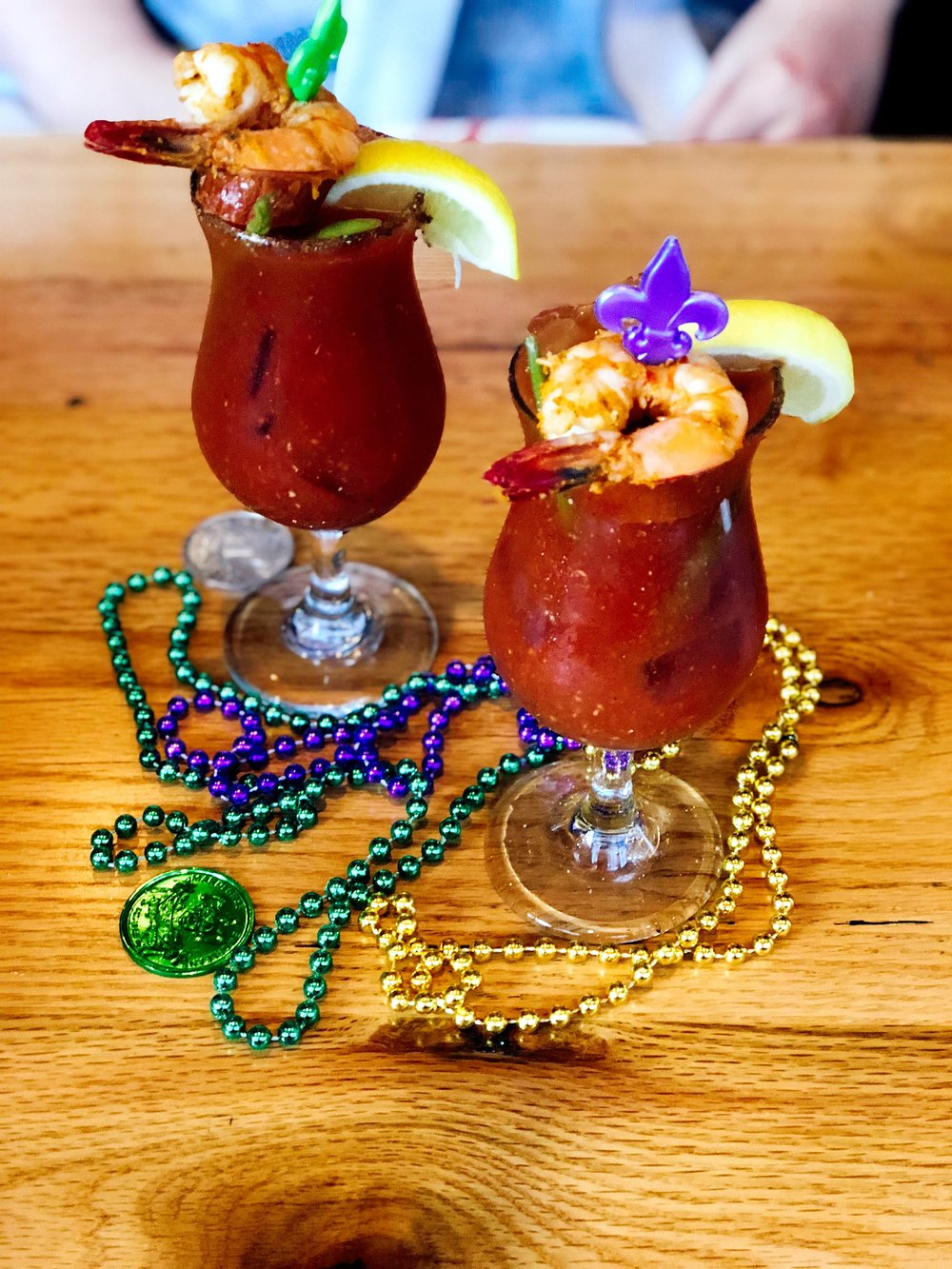 Cajun Bloody Marys Topped With Andouille Sausage and Shrimp